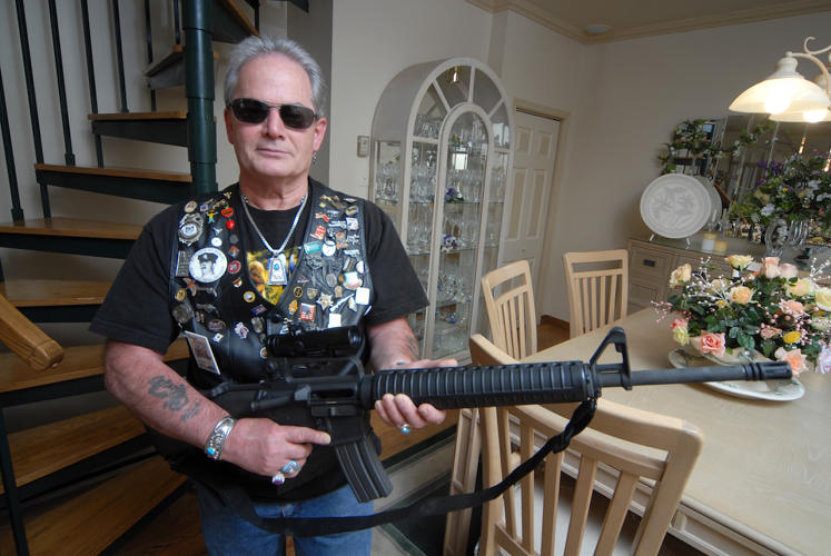 "<p>Nicky, Pennsylvania. ""I have 32 handguns and 17 long arms. I'm not a collector. I just love to purchase firearms. I don't know if I could choose—between my guns and my motorcycle.""</p>"
