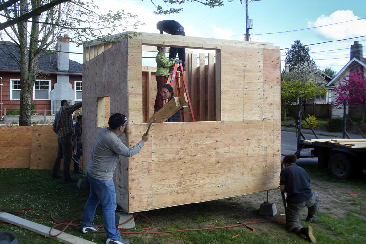 <p>The <a href=&quot;http://www.fastcoexist.com/3045168/fund-this/this-moveable-village-of-tiny-houses-for-the-homeless-was-designed-by-teenagers&quot; target=&quot;_self&quot;>largest of the tiny houses</a>, designed for a small family, was designed by students at Sawhorse Revolution, a nonprofit that works with teenagers on design-build programs.</p>