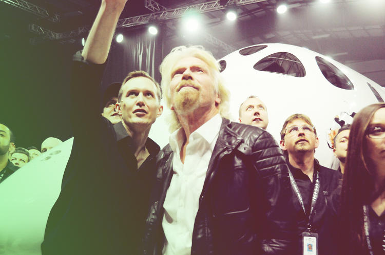 <p>Virgin Galactic CEO George Whitesides, left, talking to Branson, with the new spaceship behind them.</p>