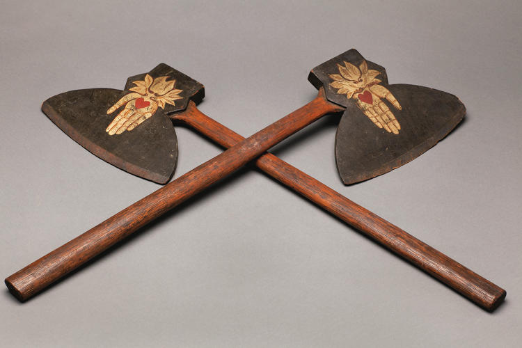 <p>Pair of Odd Fellows axes, 1870s, unidentified artist, carved wood with painted heart-in-hand decoration, each 28 inches by 8 inches by 1 inch</p>