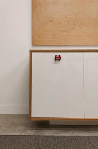 <p>Bike components as cabinet pulls are a clever little nod to SRAM's identity.</p>