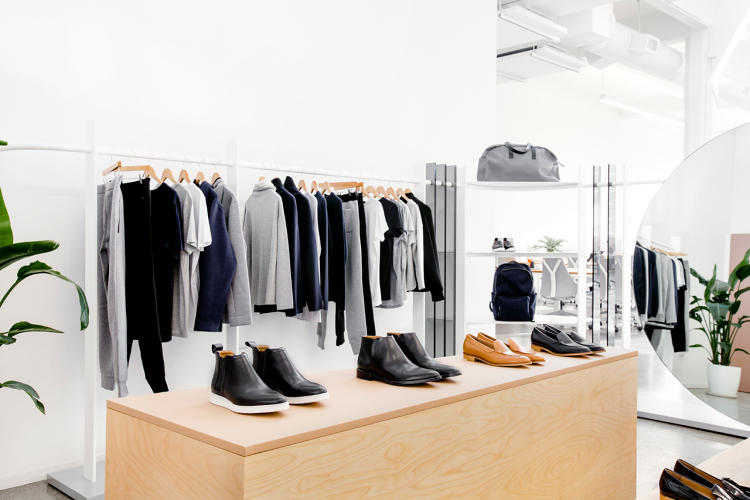<p>Wood and leather wrapped display structures function as both display surfaces, storage and seating for trying on shoes.</p>