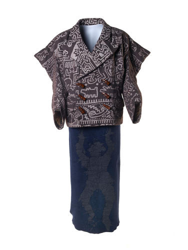 <p>An ensemble piece from the Vivienne Westwood fall/winter 1983 Witches collection featuring a wool jacket with textile designed by artist Keith Haring and a calf-length Mudman skirt in blue fleece</p>