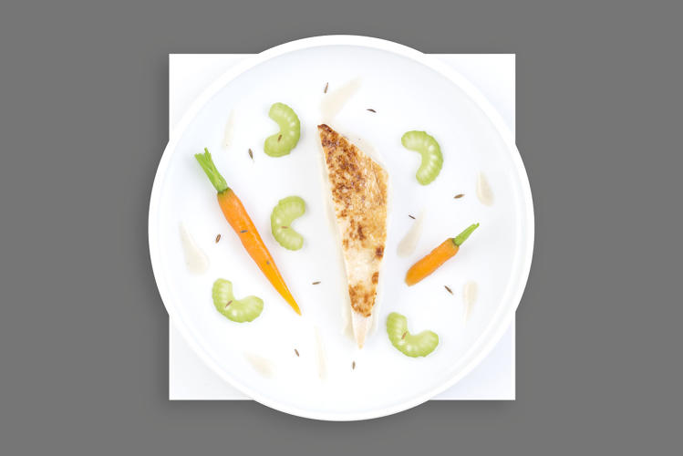 <p>Tender roast chicken fillet, carrots and celery, cumin suprême sauce—Air France</p>