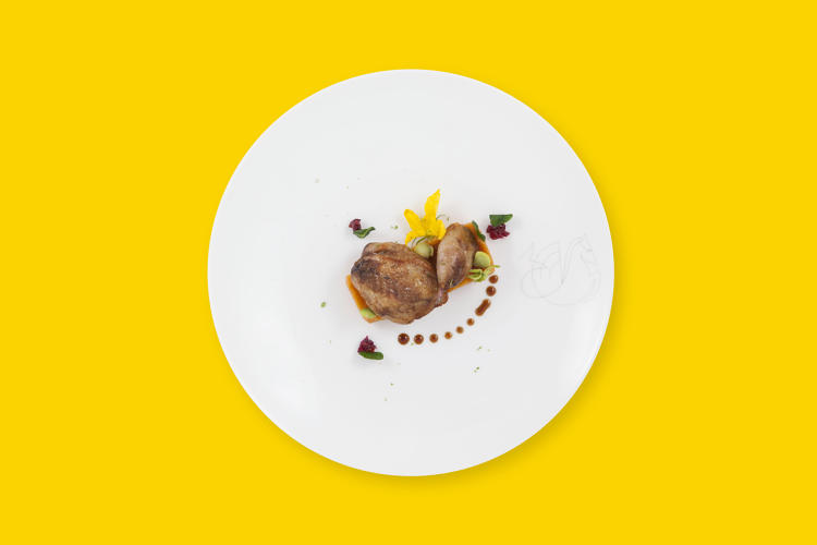 <p>Lightly breaded pigeon au jus—Air France</p>