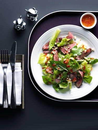 <p>Thai beef salad topped with sirloin steak, roasted pine nuts, and a chili dressing—Virgin Atlantic</p>