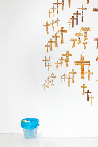 <p>Crosses and bin (crucifixes galore next to a bin)</p>