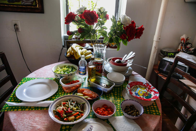 <p>Food from a pantry in Washington Heights helps Maria care for her three school-age relatives while their parents work in the Dominican Republic.</p>