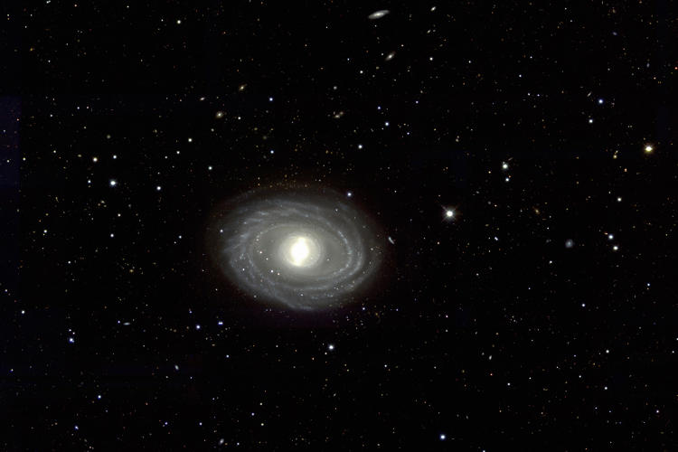 <p>This galaxy is 65 million light years away from earth (for reference, the nearest star to earth is about 4 light years away).</p>