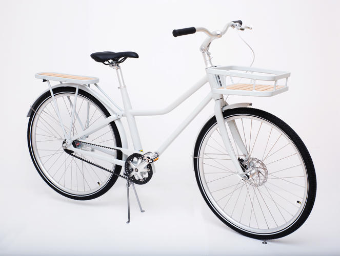 <p>The front rack is mounted on the frame, rather than the handlebar-mounted racks that are more common.</p>