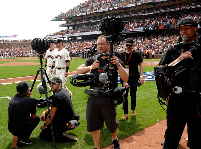 <p>Jaunt cameraman Jed Seus carries one of the company's cameras on the field at AT&amp;T Park.</p>