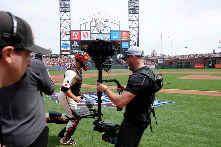 <p>Giants All-Star catcher Buster Posey runs on to the field as the Jaunt crew works.</p>