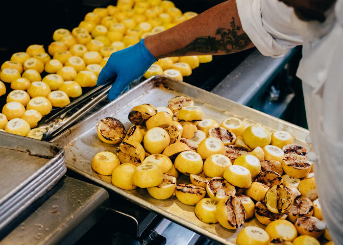 <p>Grilling the lemons at Munchery's flagship kitchen in San Francisco.</p>