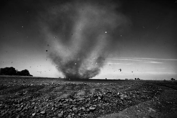 <p>A &quot;dust devil&quot; whirls across the parched landscape outside of Stratford, a town reeling from California's crippling drought. California is entering its fourth year of well below normal levels of rain and snow. The state's agricultural heartland, the Central Valley, is being especially hard hit. Towns are abandoned, fields are parched, and people are fleeing the area.</p>