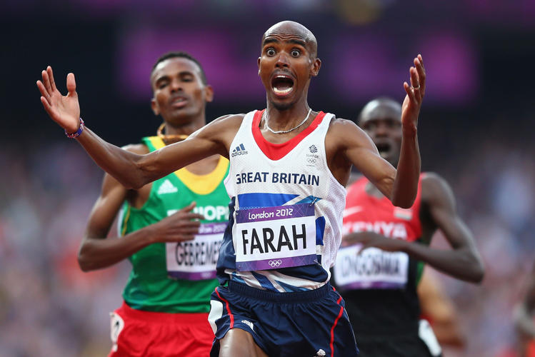 <p>LONDON, ENGLAND - AUGUST 11:  Mohamed Farah of Great Britain celebrates as he crosses the finish line to win gold ahead of Dejen Gebremeskel of Ethiopia and Thomas Pkemei Longosiwa of Kenya in the Men's 5000m Final on Day 15 of the London 2012 Olympic Games at Olympic Stadium on August 11, 2012 in London, England.</p>