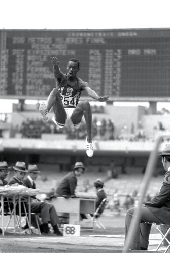 <p>Mexico City 1968: Bob Beamon #254 of the USA breaking the Long Jump World Record.</p>