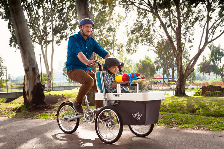 <p>When children aren't on the bike, the seats convert into a lockable cargo area that can carry groceries.</p>