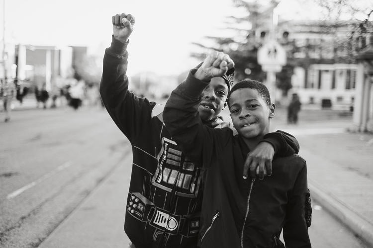 <p>Two boys at a peaceful protest and cookout on the day following a community uprising, West Baltimore, April 28, 2015. Photo: Devin Allen.</p>