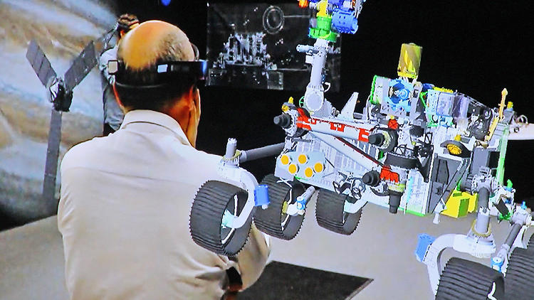 <p>A screenshot of a Mars 2020 rover hologram as seen by Curiosity mission scientist <strong>Luther Beegle</strong>'s HoloLens.</p>