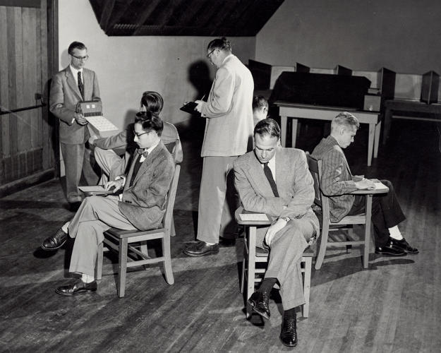 <p>Members of IPAR are seen simulating one of the tests, known as the Bingo Test, which was a measure of group behavior.</p>
