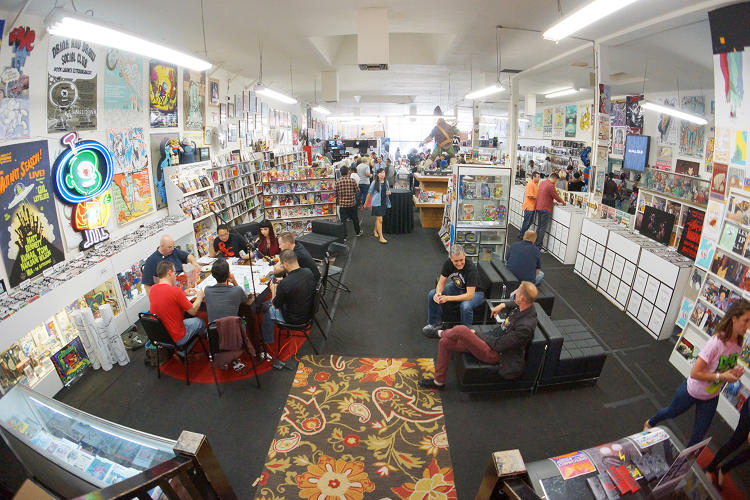 <p>The scene at Meltdown Comics, with a <em>Dungeons &amp; Dragons</em> game underway on the left</p>