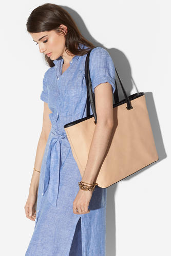 <p>The Seville laptop tote ($398) comes with a swappable nylon shell that is convenient for travel.</p>