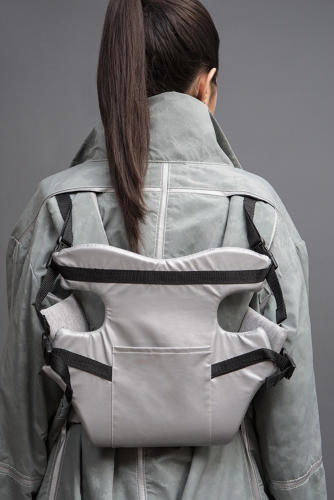 <p>She also designed a coat with an integrated child carrier.</p>