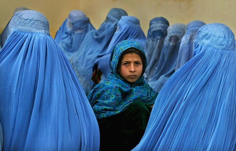 <p>Women wait in line to be treated at the <strong>health clinic</strong> in Kalakan, Afghanistan.</p>