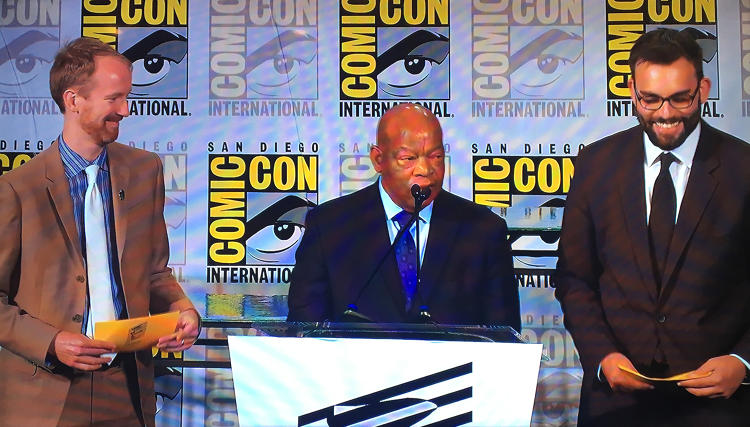 <p>Nate Powell, John Lewis, and Andrew Aydin present at the Eisner Awards, later taking home a trophy.</p>