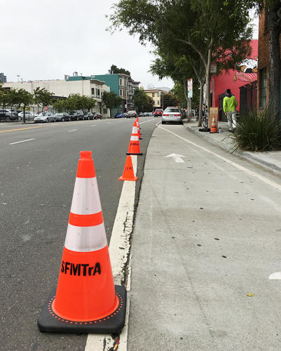 <p>When the activists put up simple orange construction cones, cars immediately started staying in their own lane.</p>