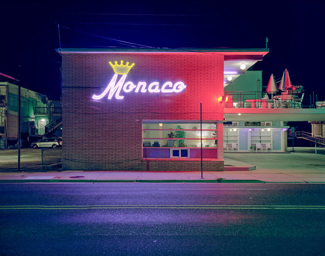 <p>The towns' neon signage is often as exuberant as the architecture.</p>