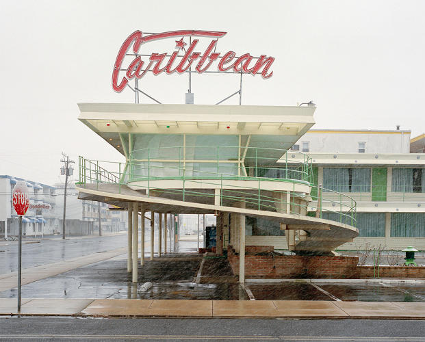 <p>The stylish neon signage and swooping architecture at the Caribbean Motel is vibrant, even through the pouring rain.</p>