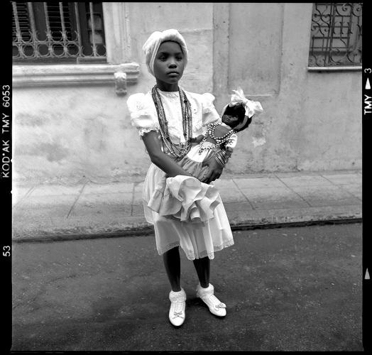<p>&quot;This little girl, like her mum and her grandparents, practices Santería, a blend of the Catholic religion and African beliefs brought to the island by black slaves,&quot; Paganelli writes in the book. &quot;Many Cubans, blacks and whites, practice Santería. She is in her final ritual of purification before becoming a Priest. The process takes a whole year, and during the waiting period, photos can't be taken, nor can she see herself in a mirror or have contact with other individuals. Santería rituals are festive and include musical ceremonies and prayers, referred to as bembé, toque de santo, or tambor.&quot;</p>