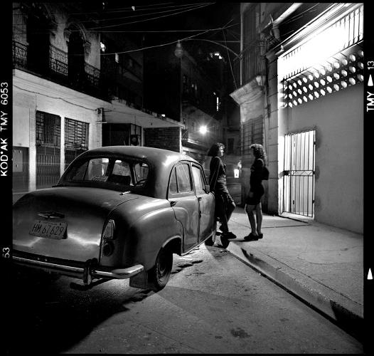 <p>&quot;These sisters wait for their dad by an antique car,&quot; Paganelli writes in the book. &quot;Their father runs a government almacén (warehouse) where food, milk, and foreign produce are stored. For a Cuban, this is a great job to have, because food never lacks at home.&quot;</p>