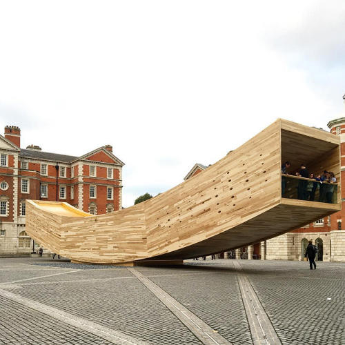<p>The Smile is a cantilevered structure by architect Alison Brooks and the engineering firm Arup. The 110-foot-long installation is fabricated from cross-laminated timber and explores the material's strength and creative potential.</p>
