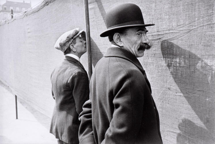 <p>A man knows he's being photographed in this street photo by Henri Cartier-Bresson, French (1908–2004).<em> Brussels</em>, 1932.</p>