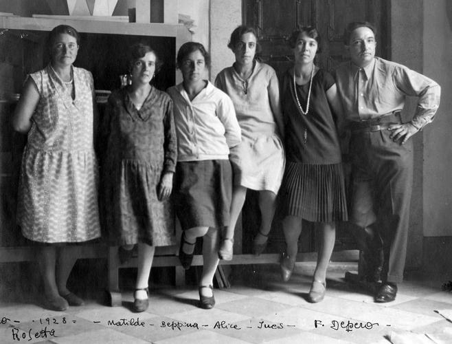 <p>Fortunato Depero, his wife, and a group of skilled women artisans who worked with him.</p>