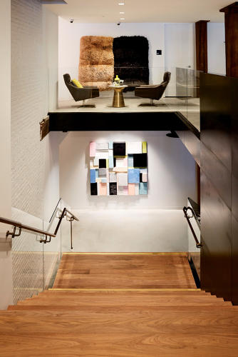 <p>A rattan wall hanging made by West Elm's vendors in the Philippines hangs on the second level.</p>