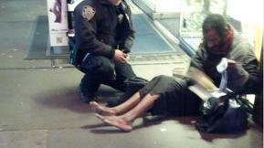 Photo Of NYPD Officer Giving Homeless Man New Boots Goes Viral After Going Up On Facebook